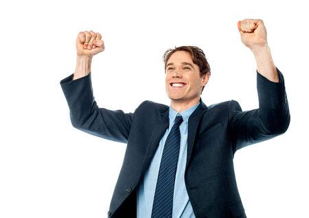 Confident young businessman celebrating his success