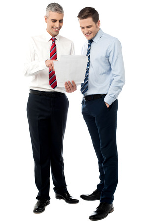 two men talking: Business colleagues discussing a project reports