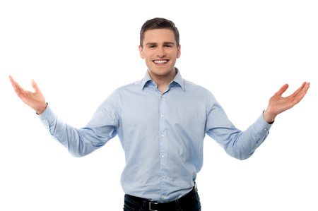 Smiling man standing with open arms, welcome gesture