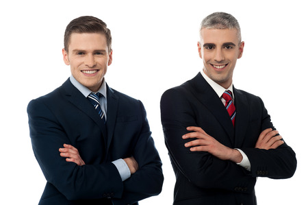 Handsome corporate executives posing confidently photo