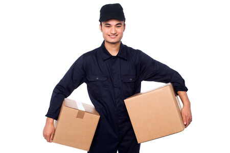 delivery service: Smiling delivery man carrying two parcel boxes Stock Photo