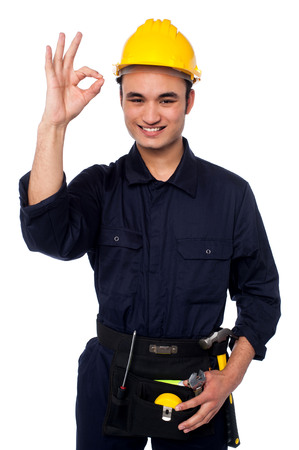 Happy worker on white background showing ok sign photo