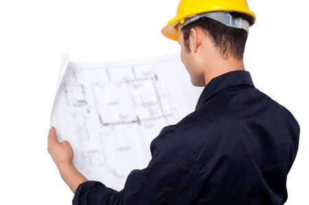 Young male engineer with construction plan photo