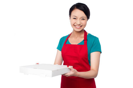 Smiling young chef deliver pizza to the customer photo