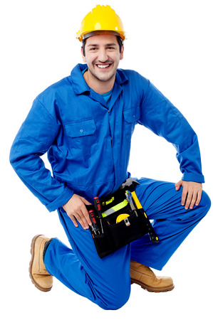 Happy worker kneels and looking at the camera photo