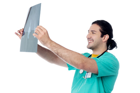Smiling doctor looking at the x-ray image
