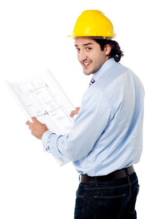 Construction worker turn around with blueprint photo