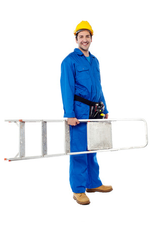 Handyman with step-ladder, isolated on white  photo