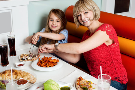Daughter enjoying meal with her mother photo