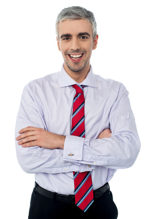 Happy business man with arms crossed photo