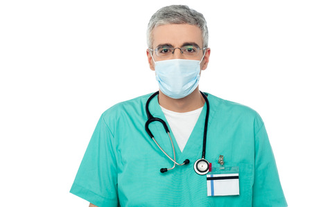 male nurse: Male physician covering face with surgical mask