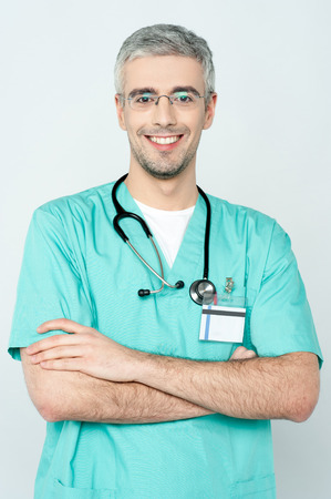 Portrait of an handsome doctor with arms folded photo