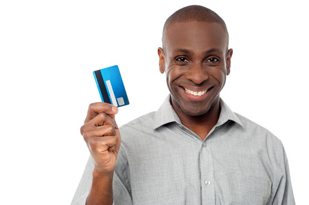 man holding money: Handsome man showing his debit card to camera