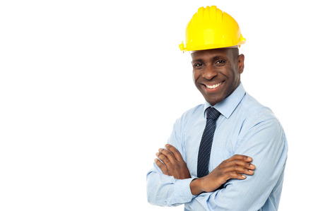 Construction engineer in hard hat with his arms crossed photo