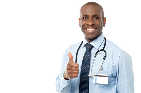 Handsome african male doctor giving thumbs up photo
