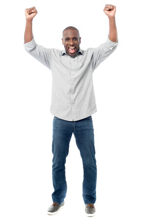 clenching fists: African middles aged man clenching fists Stock Photo