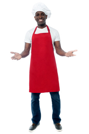 Happy male chef in uniform with his arms open photo