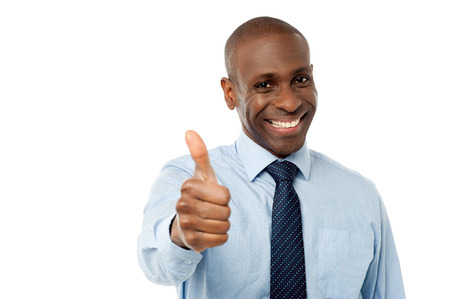 look up: Smart male manager showing thumbs up