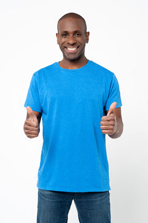 Handsome african male showing double thumbs up  photo