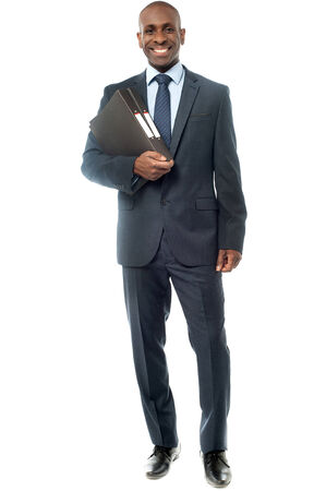 fascicule: African businessman holding a fascicule with documents  Stock Photo