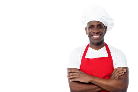 Confident middle aged chef with arms crossed photo