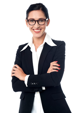 Smiling business woman with arms crossed photo