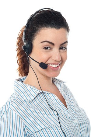 Smiling female customer support operator with headset photo