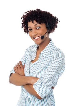 Female customer service agent posing with arms crossed photo