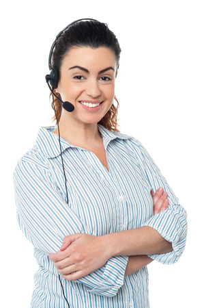 Smiling young call center woman with arms crossed photo