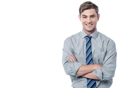 Confident young businessman with arms crossed