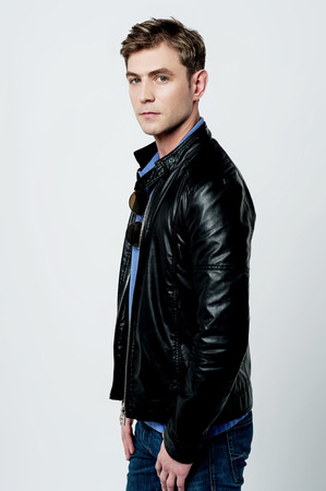 Cool young man wearing a leather jacket
