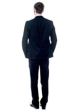 何かを見て、後ろからビジネスの男性 写真素材