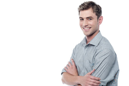 Confident young man posing with arms crossed photo