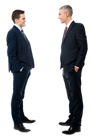 Businessmen conversation together, hands in pockets