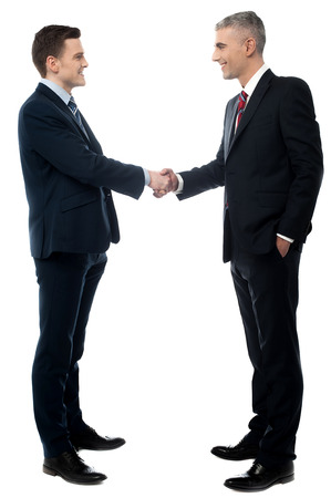 Young businessman handshaking on a white background photo