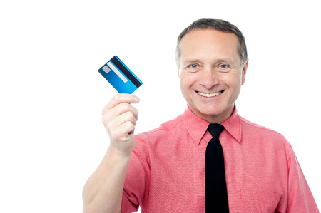 debit card: Businessman holding out his new debit card Stock Photo