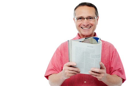 Smiling man posing with a book against white background photo