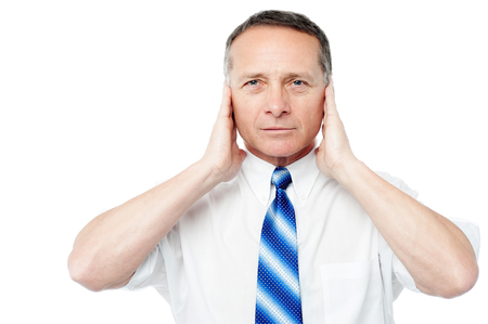 Man holding his hands up to his ears trying to mute photo