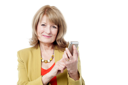 Senior businesswoman using a smart phone photo