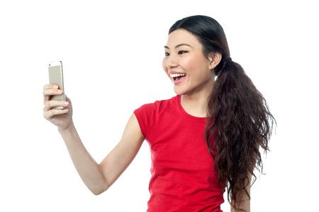 capturing: Beautiful girl capturing herself