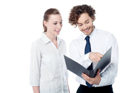 Two young businesspeople analyzing reports photo