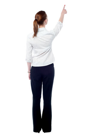 back up: Rear view of woman pointing empty space