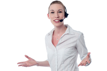 Smiling young call center executive with headset photo