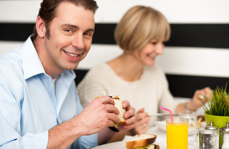 Weekend outing, couple enjoying a meal photo