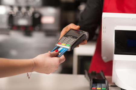Staff receiving payment by credit card in restaurant Stock Photo