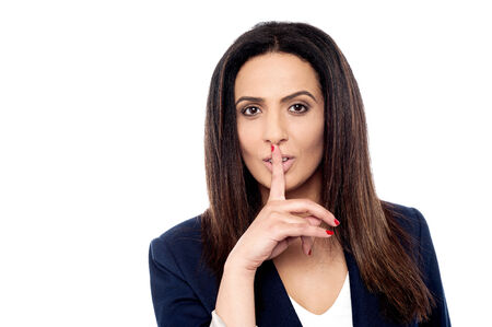 shush: Beautiful businesswoman with finger on lips, shhh!!