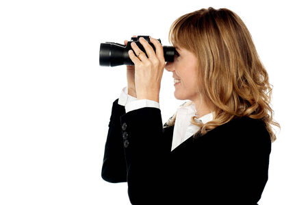 far away look: Corporate woman with binoculars searching for business Stock Photo