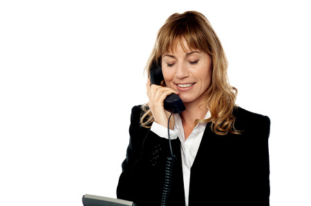 lady on phone: Middle aged help desk lady answering phone call Stock Photo