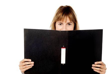 Female secretary standing behind a folder photo