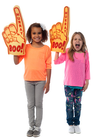 Enthusiastic sports fans with foam finger photo